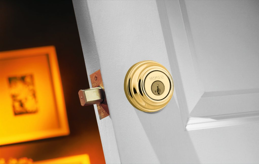 GCD9471 single cylinder deadbolt featuring smartkey in polished brass lifestyle1