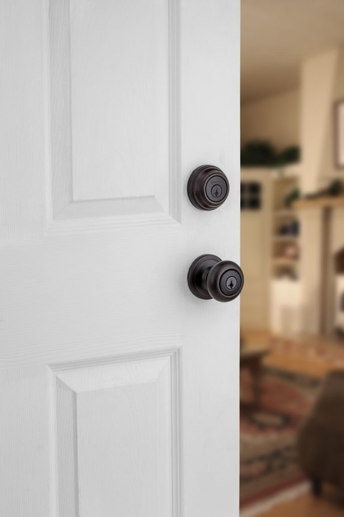 GCD9471 single cylinder deadbolt featuring smartkey in venetian bronze lifestyle1