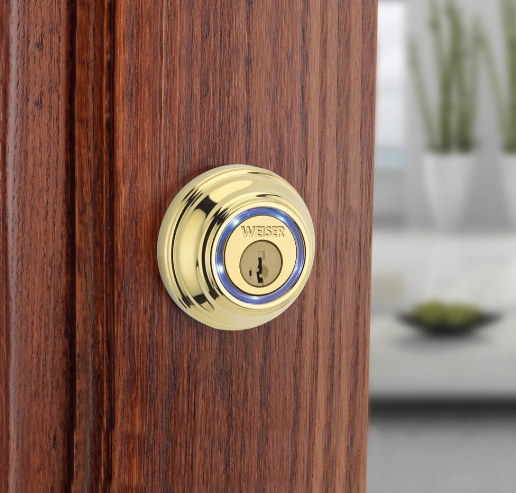 Kevo bluetooth deadbolt in polished brass lifestyle