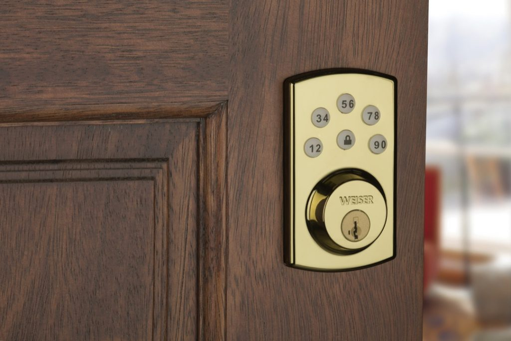 Powerbolt 2 electronic lock featuring smartkey in polished brass lifestyle