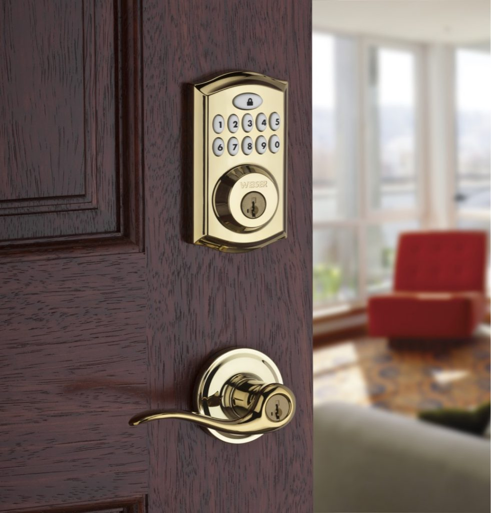 Smartcode 10 electronic lock featuring smartkey in polished brass lifestyle