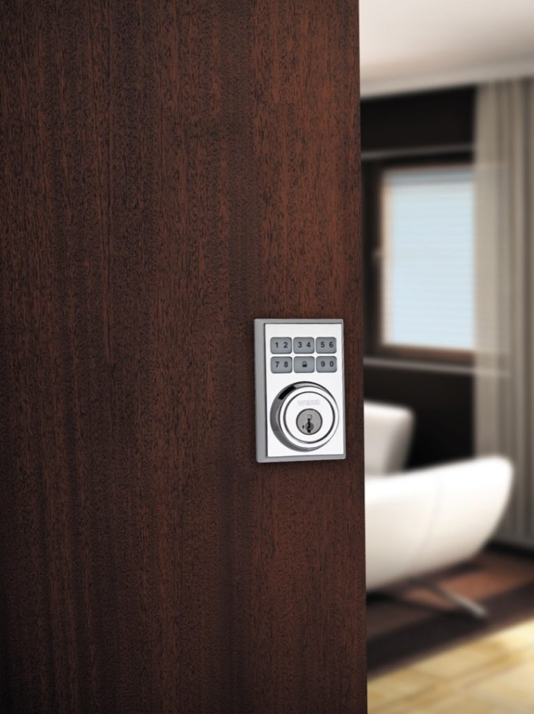 Smartcode 5 contemporary electronic lock featuring smartkey in polished chrome lifestyle