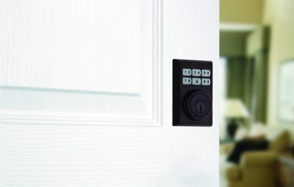 Smartcode 5 contemporary electronic lock featuring smartkey in venetian bronze lifestyle